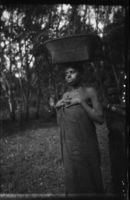 A young woman carrying a basket