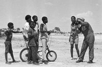 Adolescent boys with bicycle