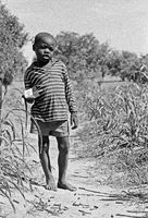 Child with remnants of a gun battle