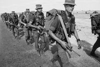 Armed South African Defence Force (SADF) conscripts marching